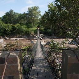 Approach to the lodge, crossing the Mkulumadzi River.