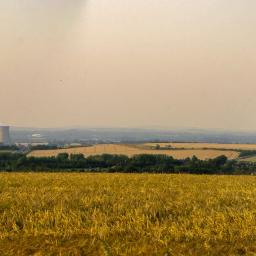 Image you are on Bury Down, on the Ridgeway, looking North.  Didcot Power Station is 5 miles away, Jet is 7, and the distant Oxford Hills are 12. Image now instead of a slope, a drop of 2000 foot, and that gives you some idea of what it's like to stand on the edge of the Ngorongoro Crater.
