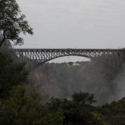 Falls bridge with Victoria Falls Hotel (Zimbabwe) beyond